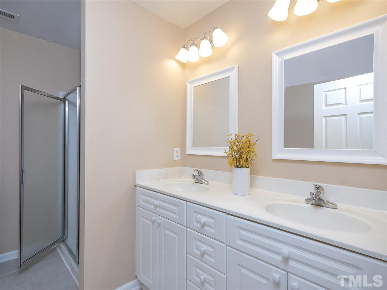 Lovely white cabinets, dual sinks, separate shower and tub, tile floor!
