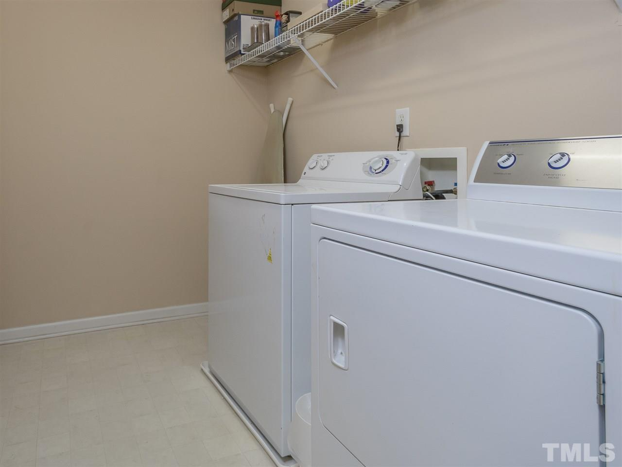 Wait until you see the size of this laundry room! It's huge! And it has a closet as well!