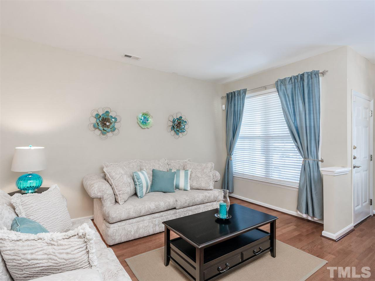 Hard to believe you're in a townhome with the natural light coming in! This home is better than new! Lots of updates!