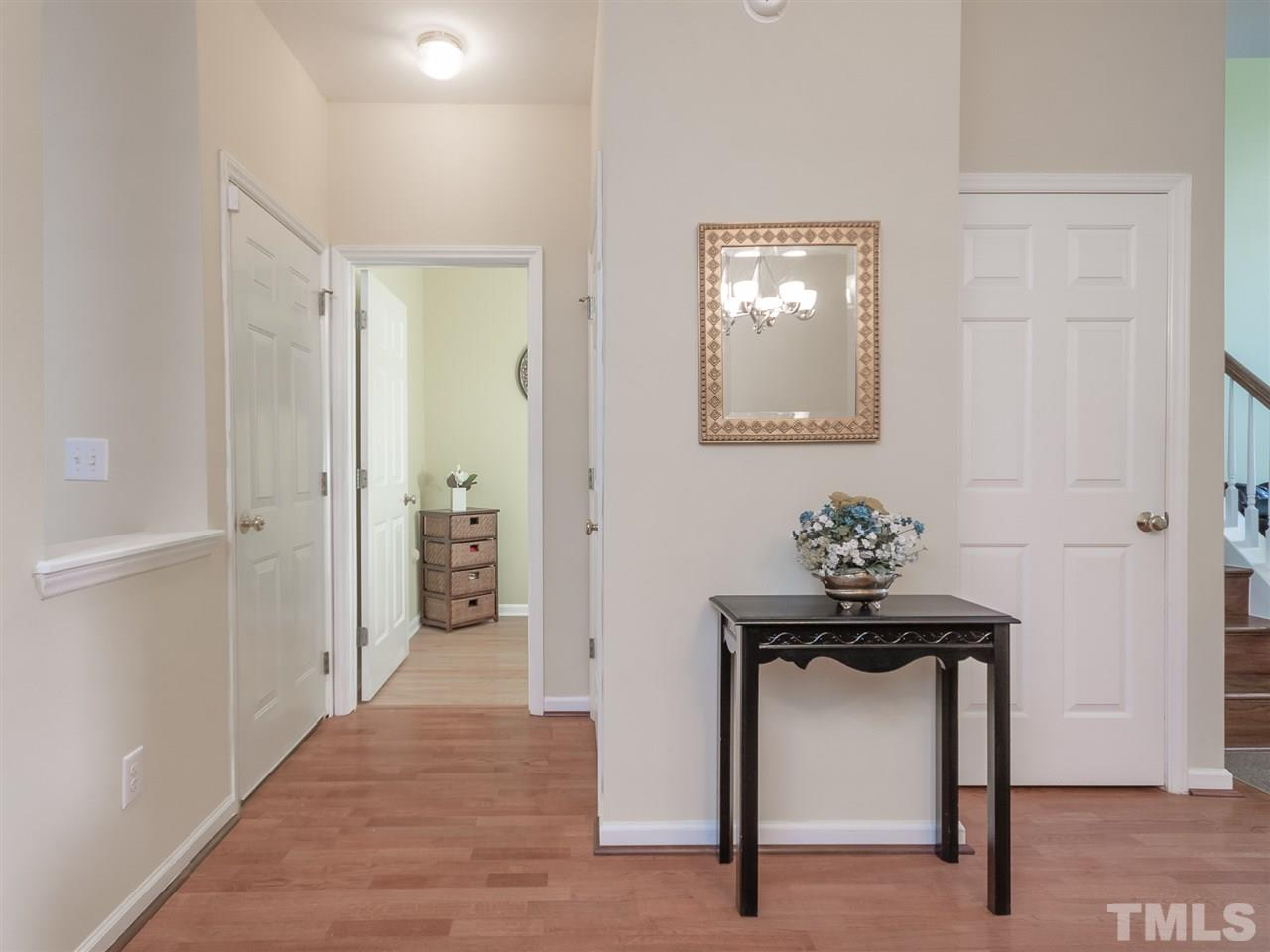This hallway leads to the first floor half bath that is huge! A coat closet and door to the garage! And there is another closet as well! Yes, this home has it all!