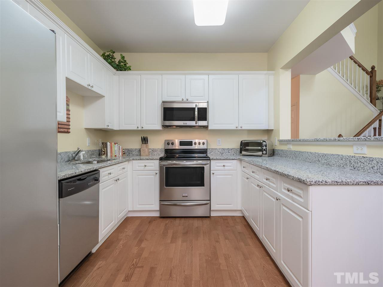 Bright and cheery kitchen with white cabinets! GRANITE COUNTERS INSTALLED! MICROWAVE JUST REPLACED! MUST SEE!!! SO BEAUTIFUL!