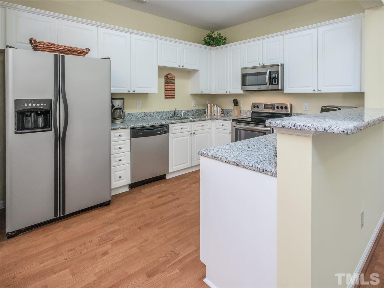 This kitchen is superb! Lots of counter space and cabinets, stainless appliances, open to the family room...sooo nice! Range is less than a year old! New Microwave and NEW GRANITE!!!