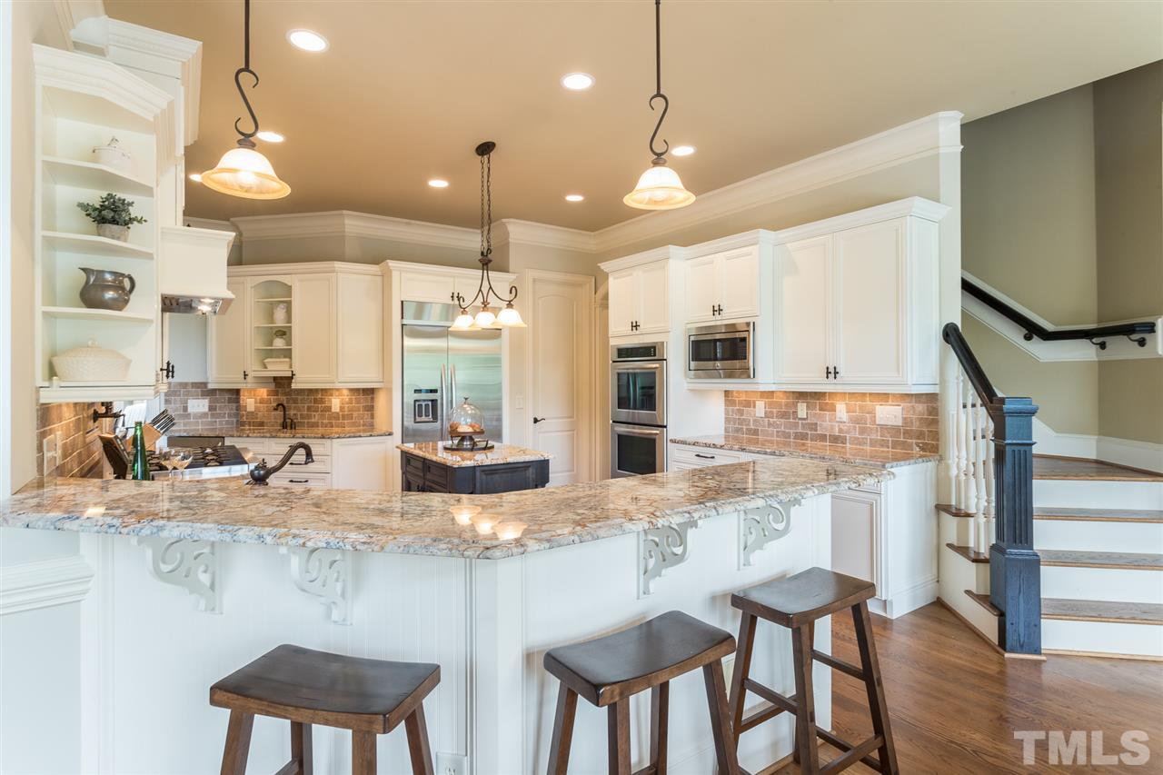 Large breakfast area opens to keeping room and family room and overlooks the outdoor deck.