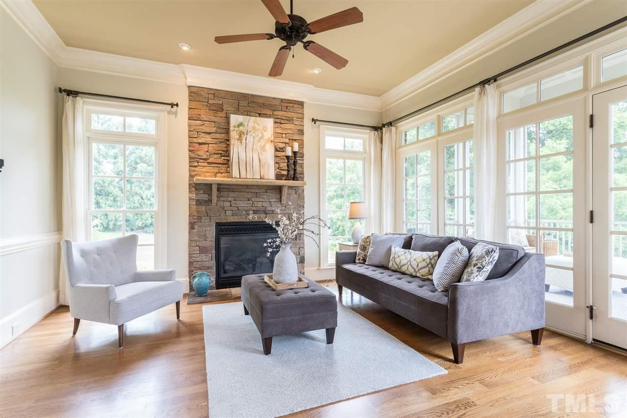 Features vaulted ceiling, built-ins and beautiful cast stone fireplace.