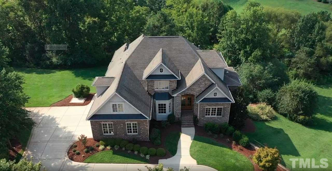 Beautiful brick and stone home w/shake gables in The Registry at Bailey Farm.