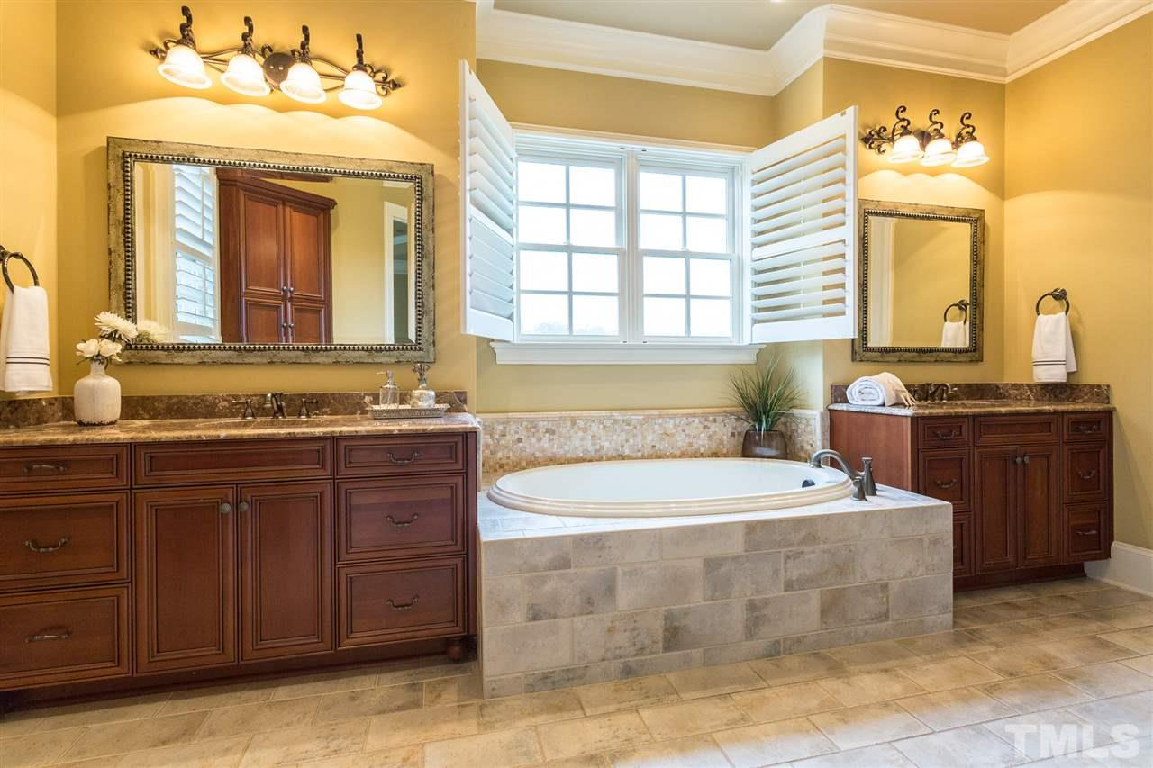 4 large secondary bedrooms--each with its own ensuite bath & large closets (3 of which are walk-in).