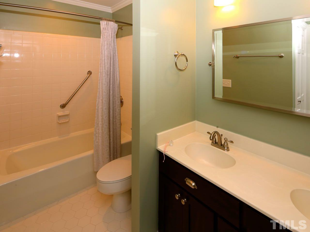 The second full bathroom also has a tile floor and a relatively-new vanity.