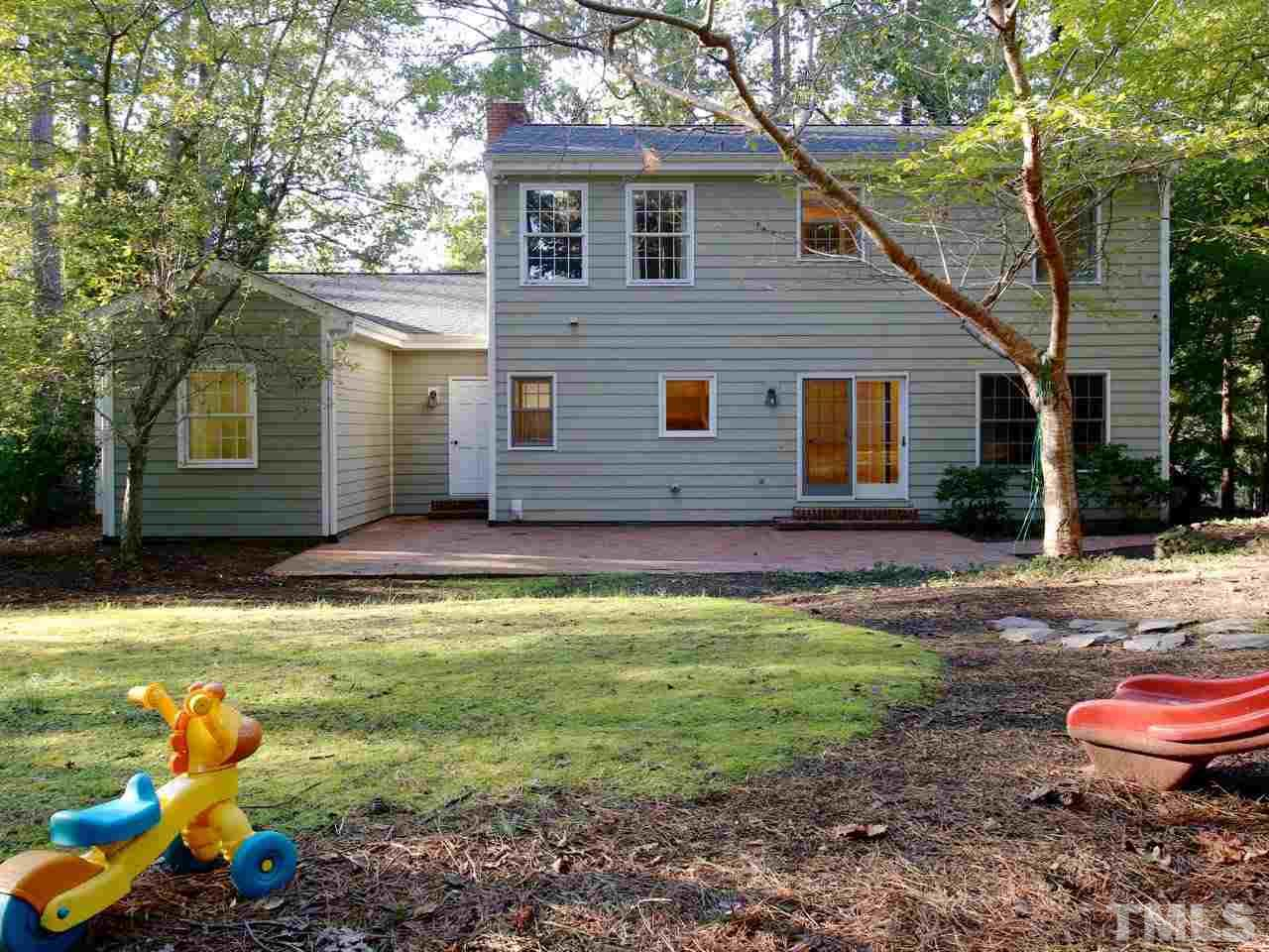 The back yard is large and level. There is a detached storage shed, a swing set, and a slide. What more do you really need?