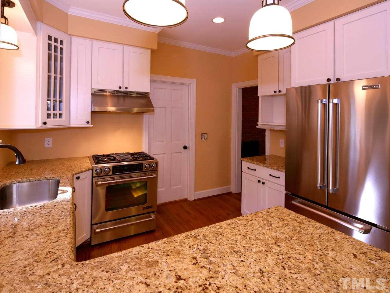 The kitchen is not large, but it is extremely functional. Everything you need is just three steps away. The counter tops are granite. And the custom-made pantry shelves are furniture quality.