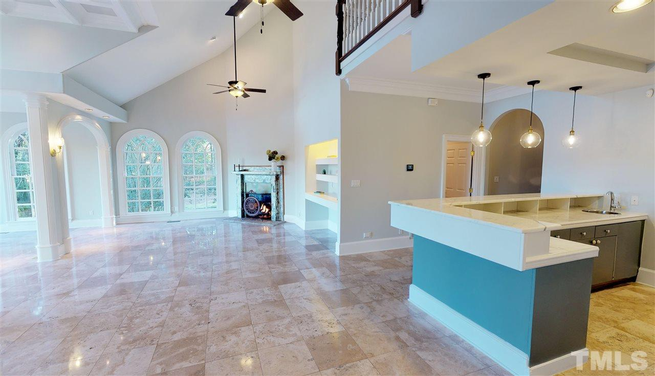 Entertaining abounds in this luxurious home, with wet bar and views for days