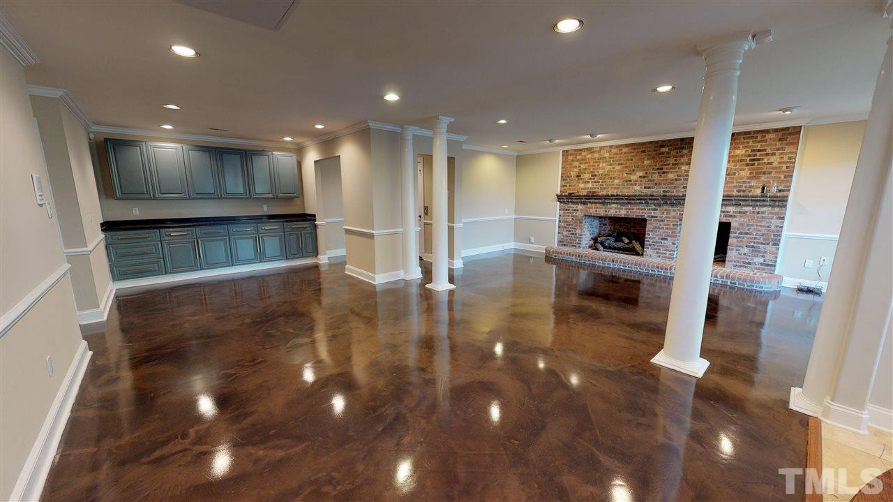 Full basement w/ garage access, elevator access, full bathroom and bedroom w/ walk-in closet, exercise room, fireplace, sauna, steam shower and storage. Room for pool table, sleep overs and more