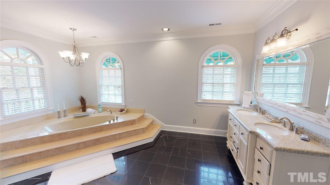 Whirpool tub, with separate water closets,  generous storage with lots of light overlooking the courtyard and front balcony