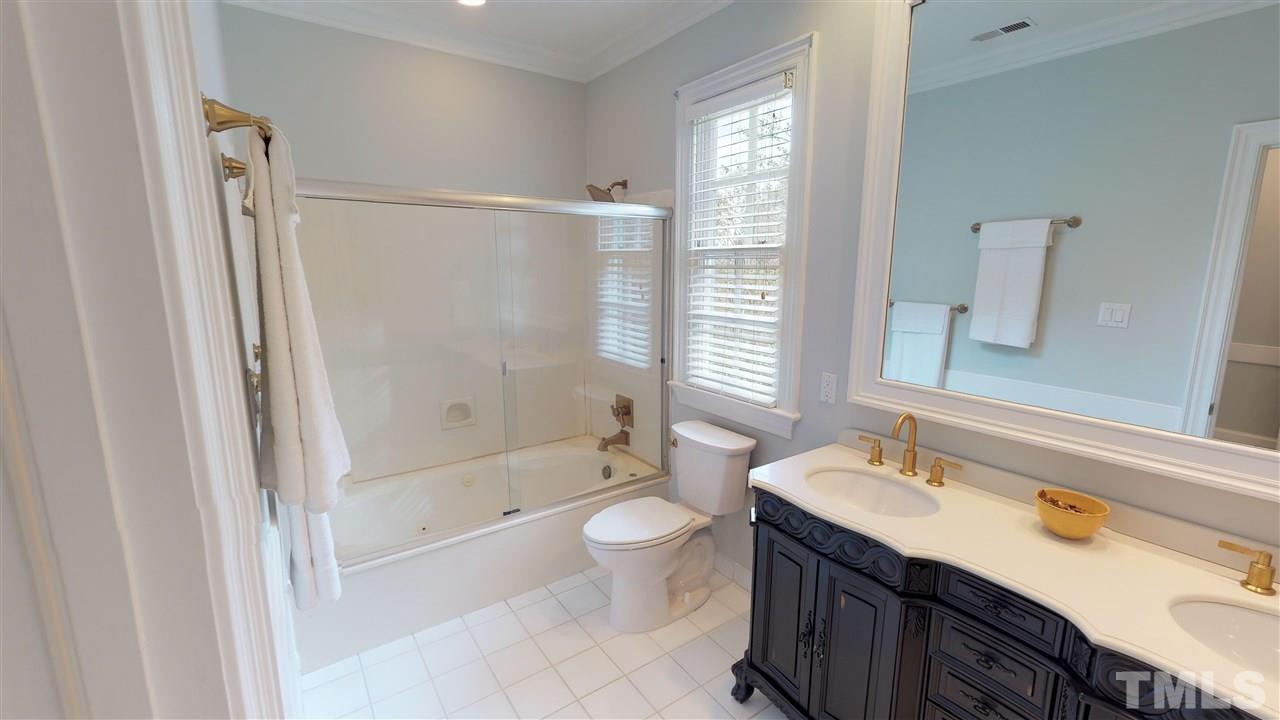 Full secondary bathroom w/ dual sinks, granite