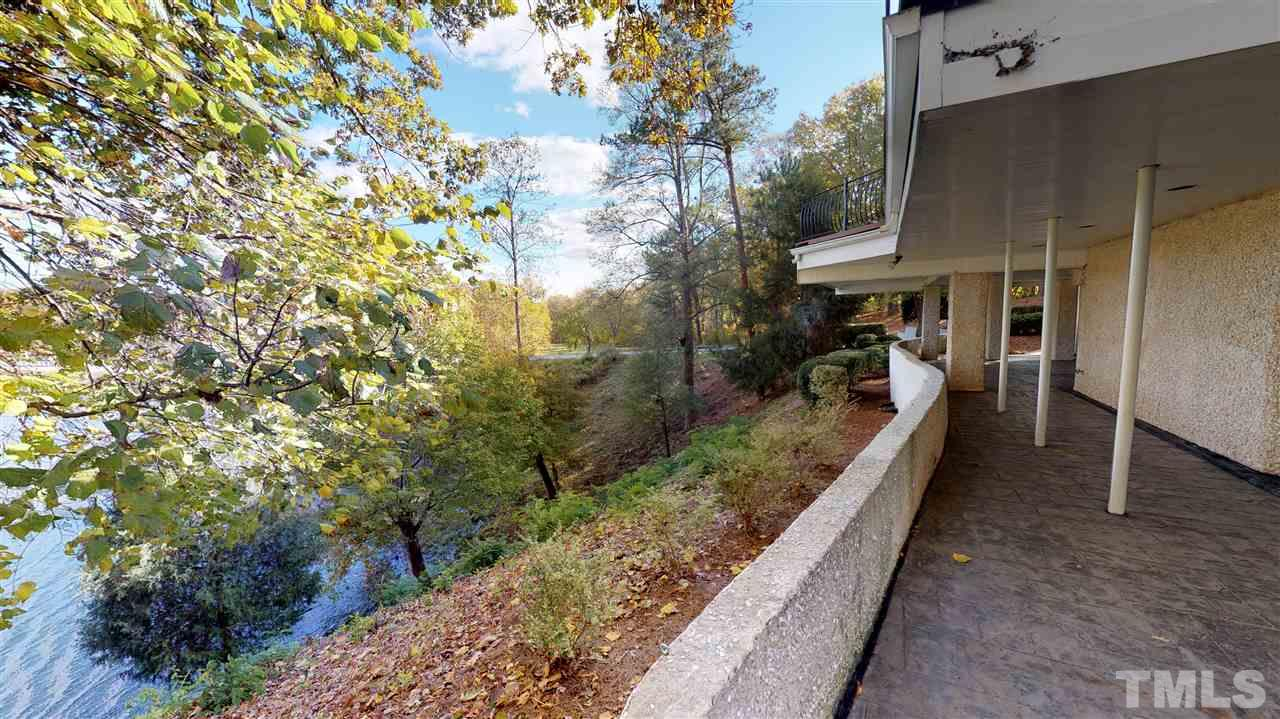 Deck stretches the entire span of the back of the house with great views of the lake, tennis courts, and golf course.