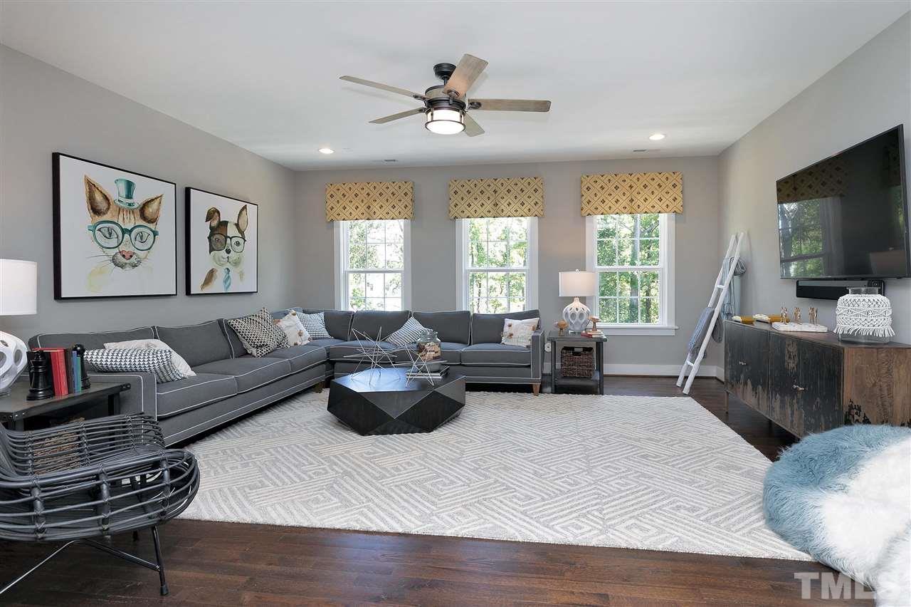 Great bonus room or loft at top of stairs. Study area , hardwood floors.