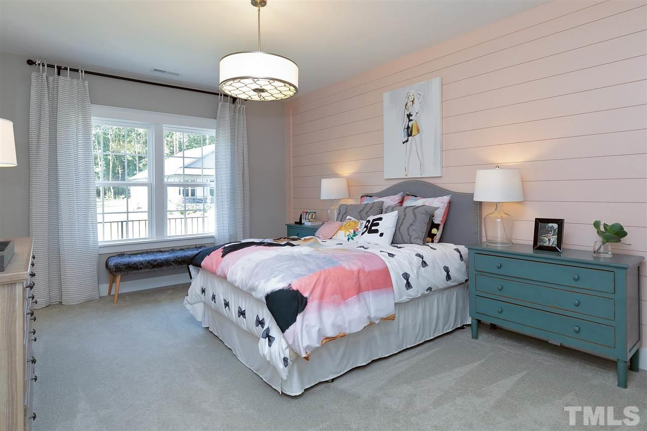 Wow to bedroom with full bath, ship lap wall and walk-in closet.