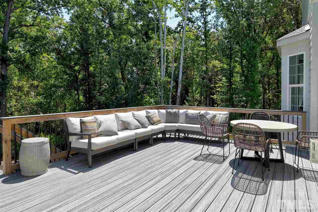 Entertain on your upgraded trex deck, overlooking wooded back yard.