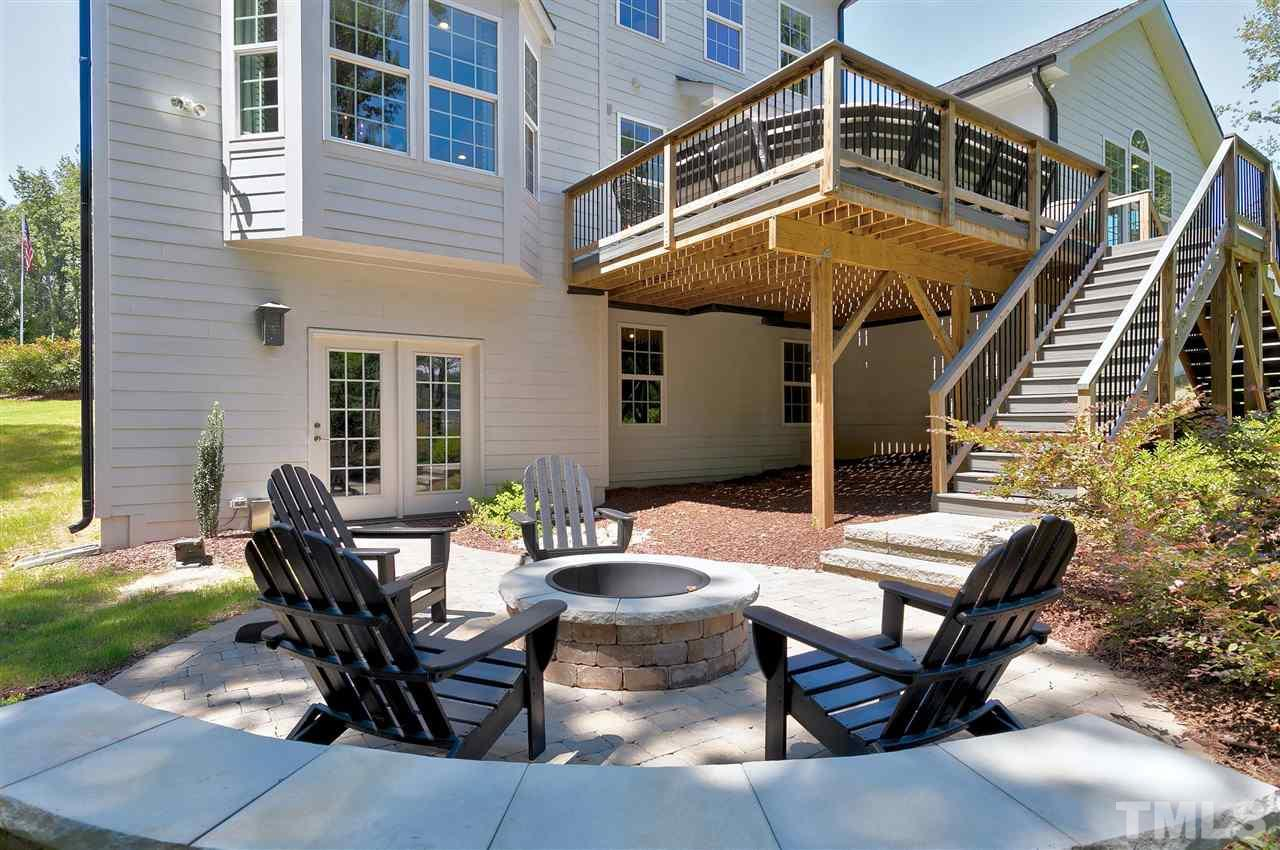Relax on your patio with fire pit. Enter this area from your full unfinished basement.