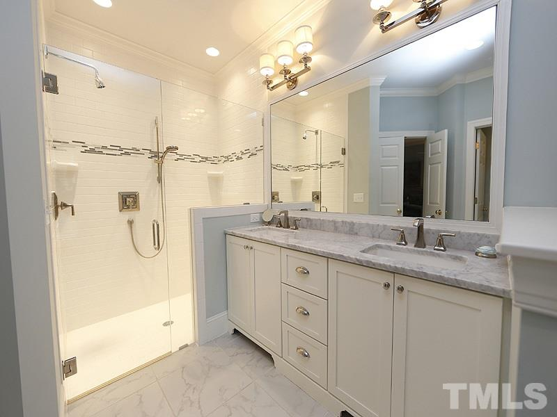 Beautifully appointed Master Bath offers Dual Sinks, Granite Countertops, Tub and large tiled Shower w/ frameless Glass Enclosure.