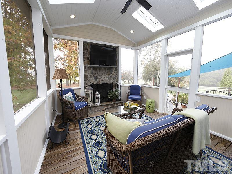 The Vaulted Ceiling and Stone Fireplace will give you the feeling of a mountain retreat in the cool months! This Porch has been designed & built for easy conversion Buyers to an all-season Sunroom.