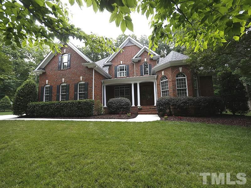 This view shows the back of the home...brick all around, intricate design, nice yard space!