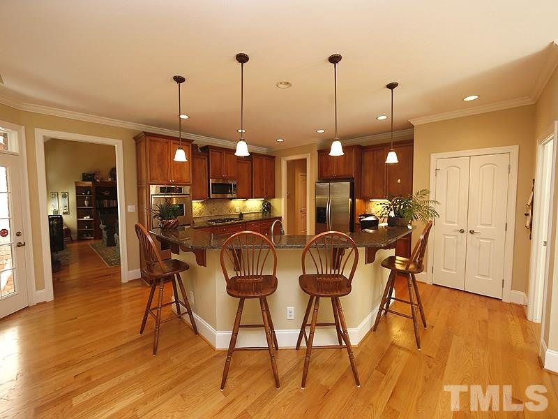 Plenty of room for the whole family or a large gathering of friends, this kitchen has a huge angled snack counter.