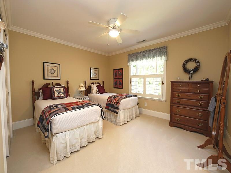 This bedroom faces the front yard, has plantation shutters, sliding closet doors and en suite bathroom..