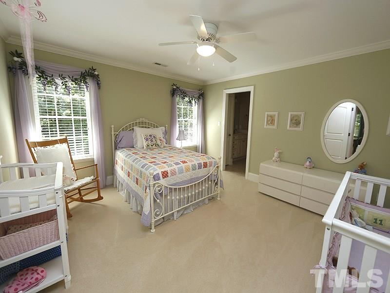 What a sweet bedroom: sage green walls, soft colors, access to Jack and Jill bathroom.
