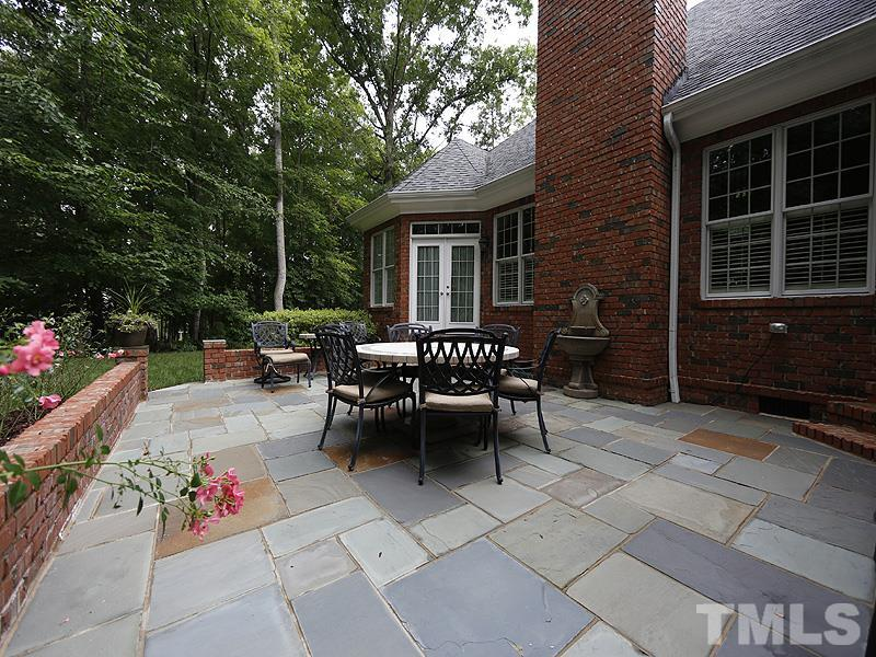 You will spend lots of time enjoying your private back yard on this patio with blue stone floor and demi wall. Surrounded by flowering and fragrant rose and gardenia bushes, this is the perfect place for bbq's and entertaining.