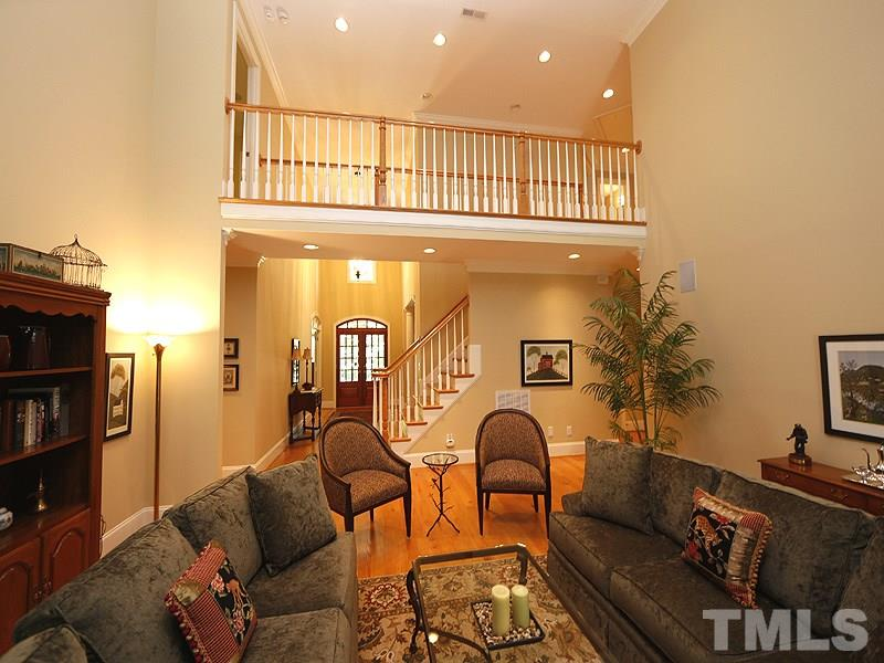 Catwalk overlooks both the living room and foyer. Hardwood floors grace the first floor, staircase and upstairs hall. All bedrooms have neutral toned carpeting.