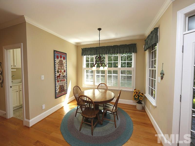 With all the natural lighting from lots of windows, this room feels more like a sunroom. Plantation shutters.