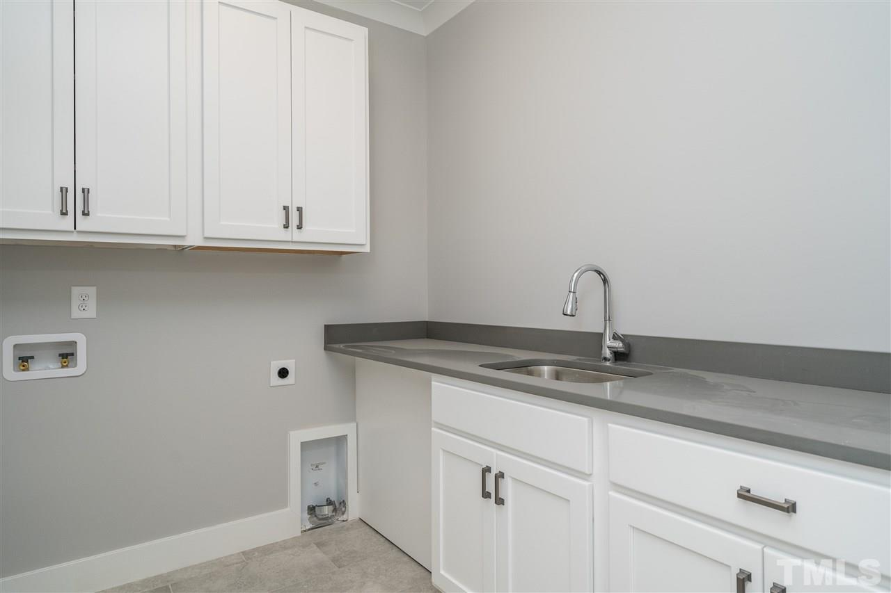 Generous laundry located near the secondary bedrooms