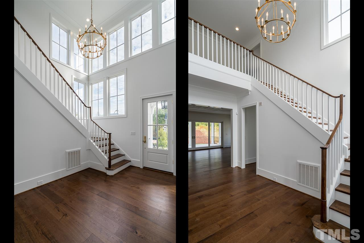 Dramatic two story foyer welcomes your guests into this luxurious home.