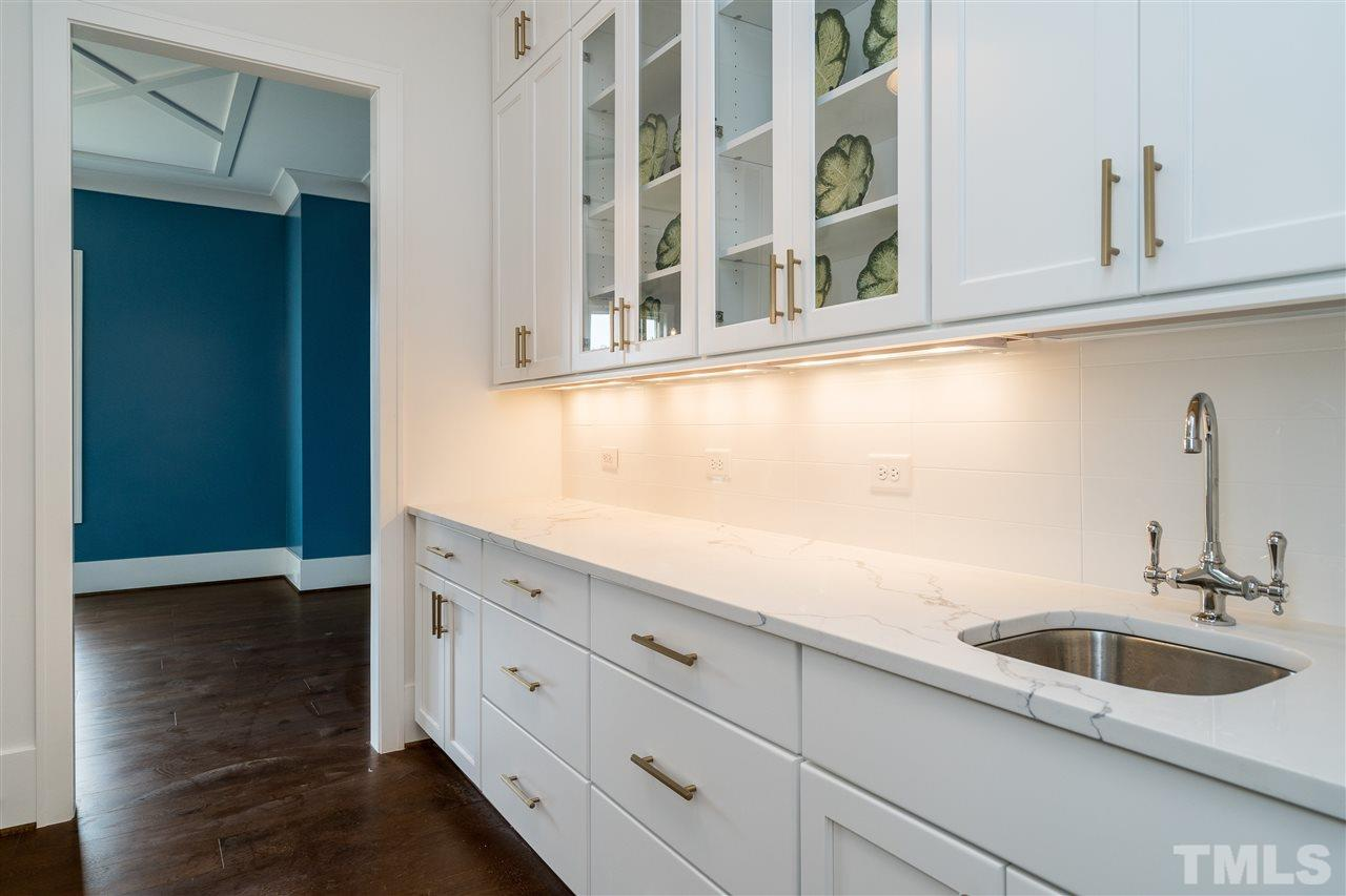 large area for serving/entertaining and storage between kitchen and dining area.
