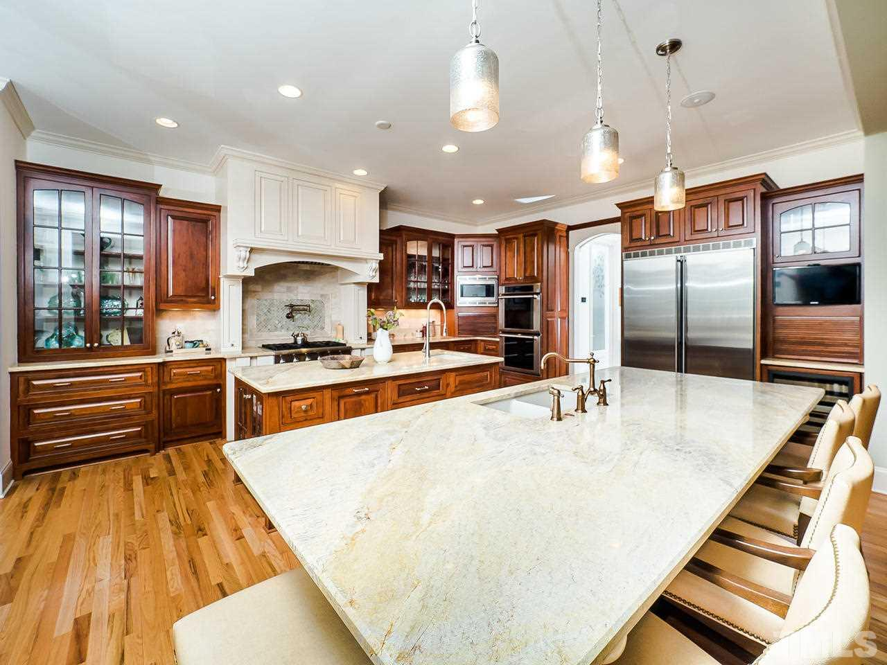 Double ovens, gas cooktop, built in Liebherr refrigerator & wine fridge make this a dream Kitchen.