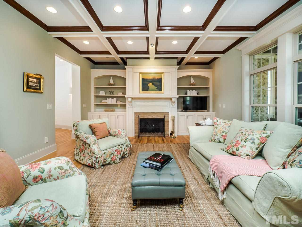 Gorgeous coffered ceilings define this relaxing Family Room.