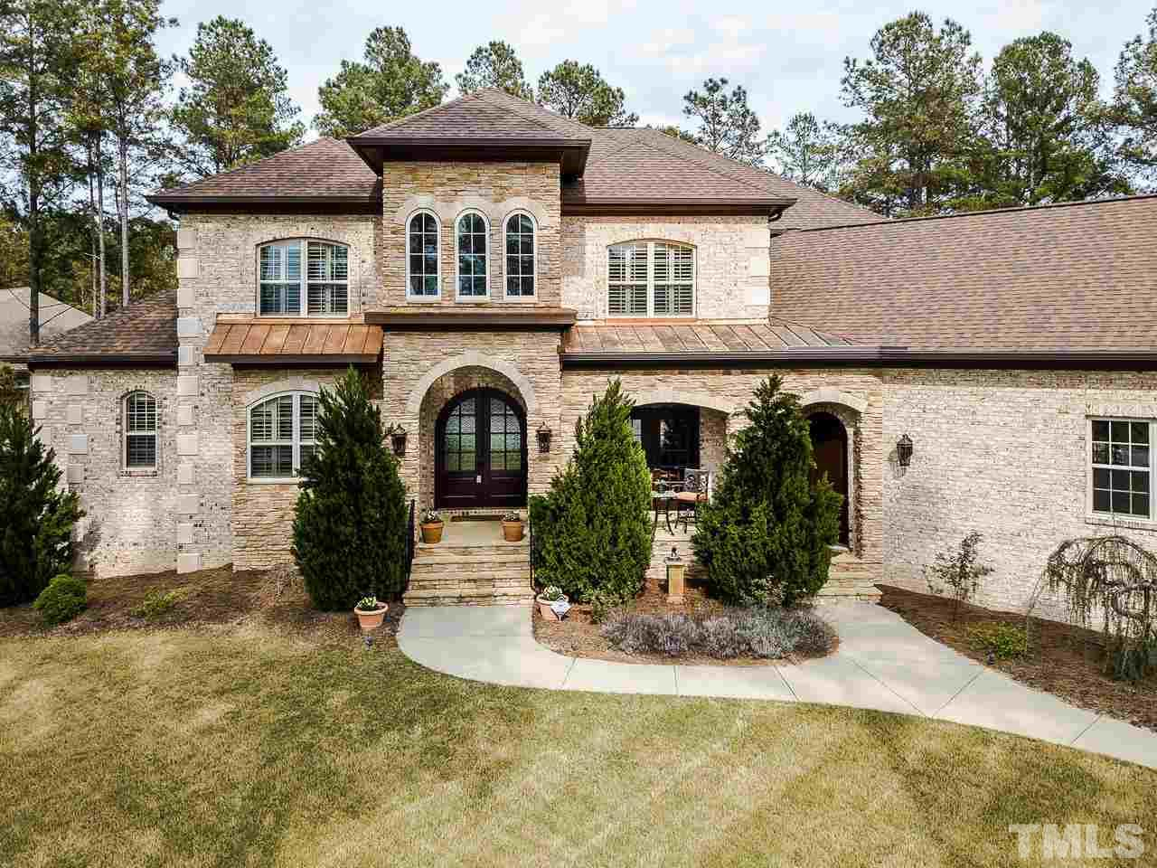 Italian Tuscan style all-brick home is full of amazing features!