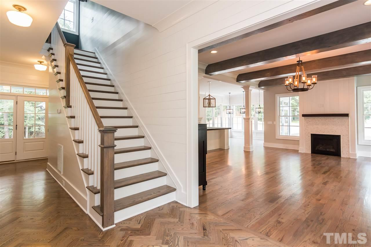 fm realty entry foyer has herringbone patterned site finished hardwood floors classic red door true