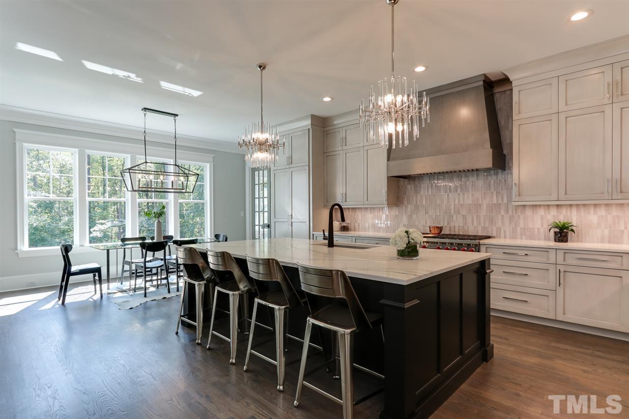 Custom cabinets, Quartz counters, designer tile backsplash.