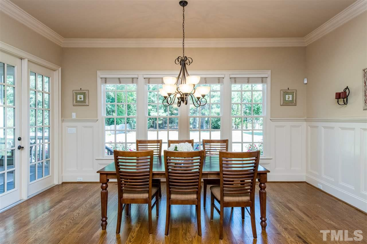 Oversized Breakfast nook with Wall of windows overlooking Large Flat Rear Yard