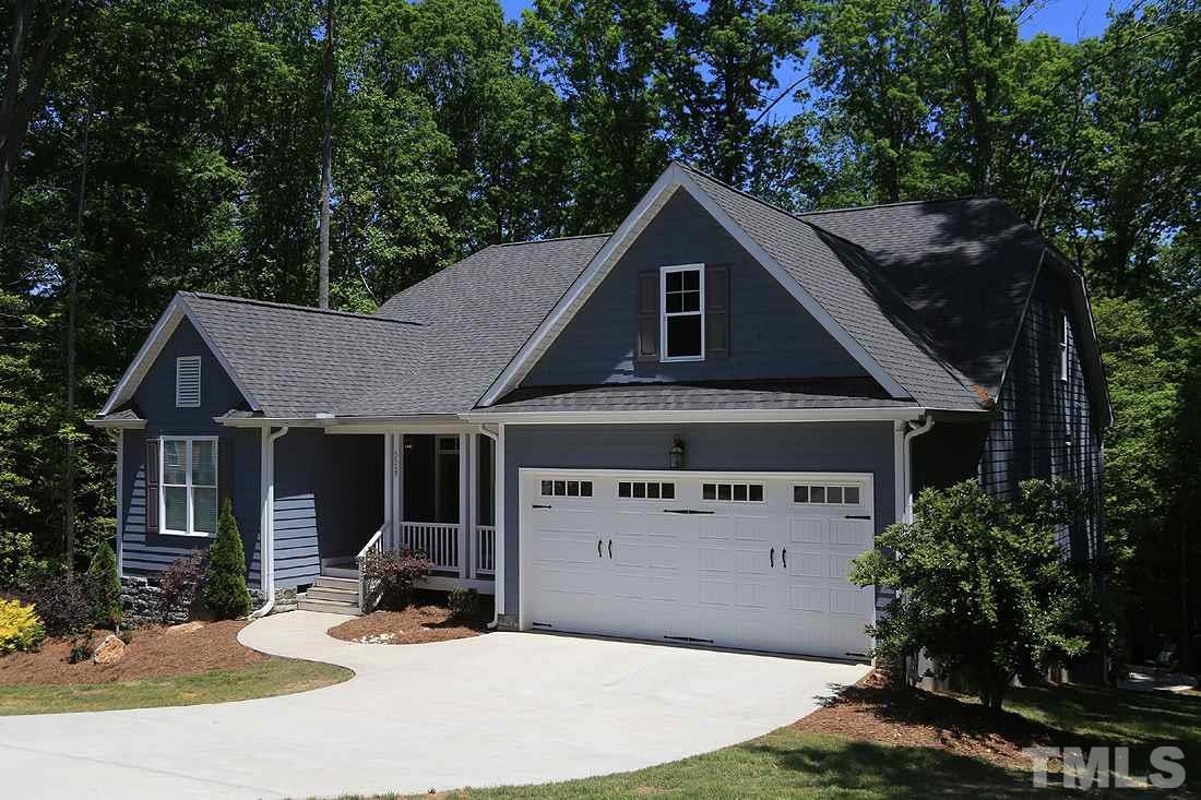 This home boasts a spacious, 2 car garage.