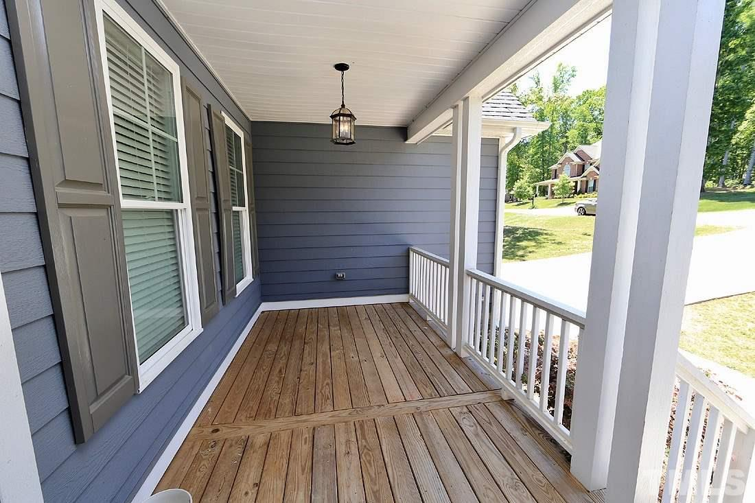 Imagine relaxing on this beautiful rocking chair front porch, watching the world go by with the breeze on your face and favorite beverage in hand...