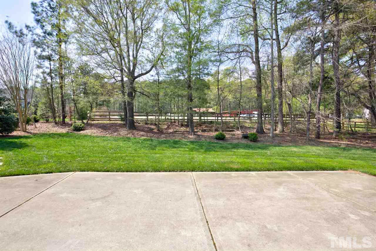 This home has a private rear view, backs to pretty 10 acre horse property.