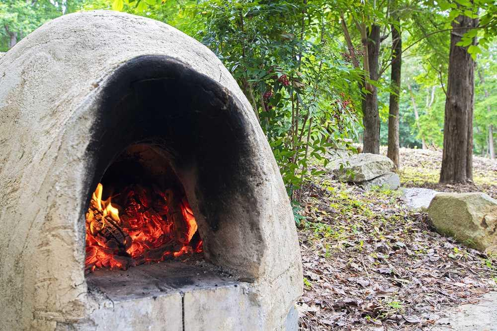 Outdoor wood-fired clay oven
