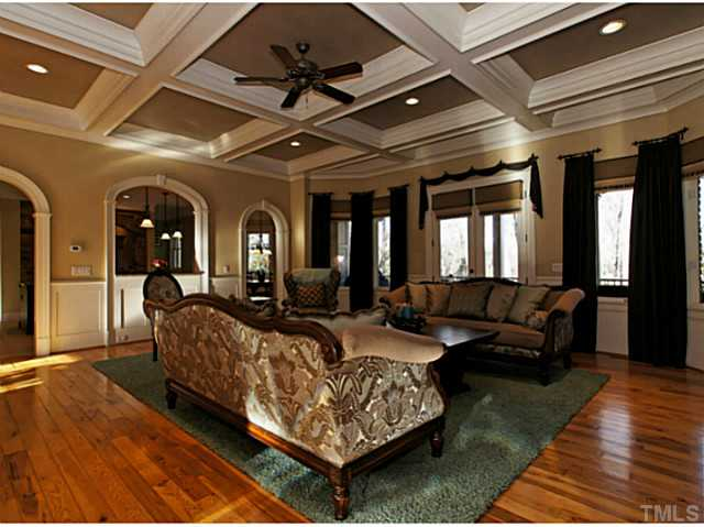 Gleaming hardwoods in great room w/coffered ceiling and stone fireplace!