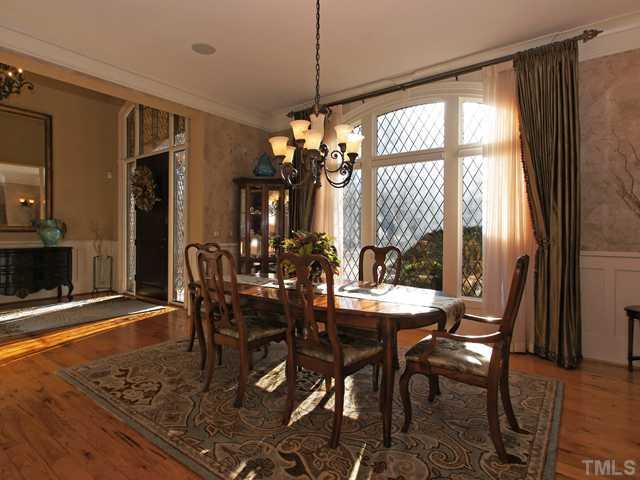 Massive dining room w/leaded style glass windows!