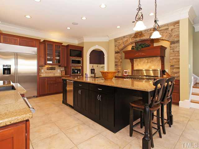 Chefs dream kitchen w/massive island, stone & cherry cabinets!