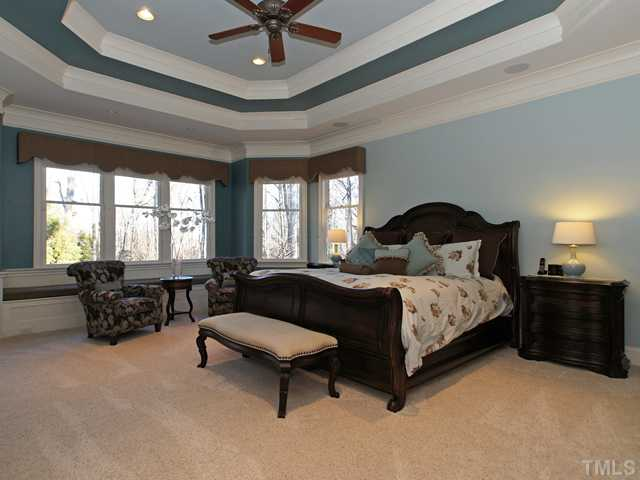 Massive Master Suite with trey ceiling & hide away flat screen TV.