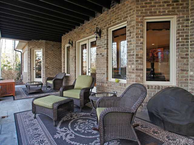 Lower covered patio that overlooks amazing pool!