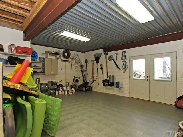 This great workshop leads you right to the pool area.  No more clutter in your 3 car garage!